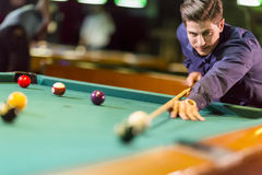 Young man playing pool Royalty Free Stock Images