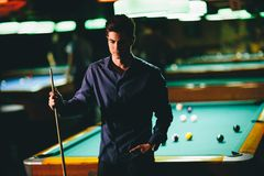 Young man playing pool. View of the young man playing pool Stock Photography