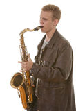 Young man playing saxophone Royalty Free Stock Image