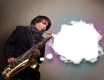 Young man playing on saxophone with copy space in white cloud Royalty Free Stock Images