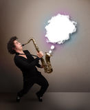 Young man playing on saxophone with copy space in white cloud Royalty Free Stock Photos