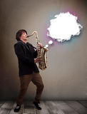 Young man playing on saxophone with copy space in white cloud Royalty Free Stock Image