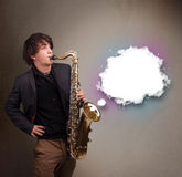 Young man playing on saxophone with copy space in white cloud Royalty Free Stock Photography