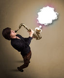 Young man playing on saxophone with copy space in white cloud Stock Photo