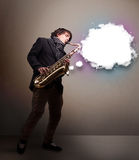 Young man playing on saxophone with copy space in white cloud Stock Images
