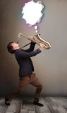 Young man playing on saxophone with copy space in white cloud Royalty Free Stock Photo