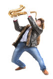 Young man playing on saxophone Royalty Free Stock Images