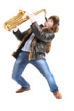 Young man playing on saxophone Royalty Free Stock Photo
