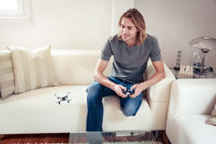 Young Man Playing With A Small Quadrocopter Drone Stock Images
