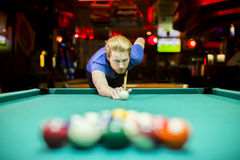 Young man playing snooker Stock Photo