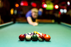 Young man playing snooker. In the bar Royalty Free Stock Photography