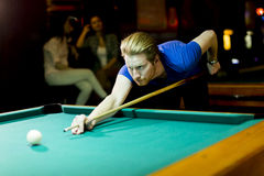 Young man playing snooker. In the bar Stock Image