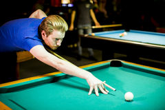 Young man playing snooker. In the bar Royalty Free Stock Images