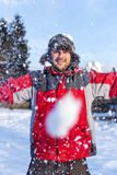 Young man playing with snow Royalty Free Stock Images