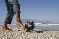 Young Man Playing Soccer On Beach Royalty Free Stock Photography