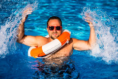 Young man playing in swimming pool Royalty Free Stock Image