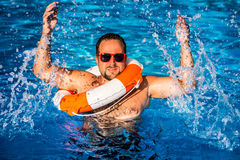 Young man playing in swimming pool Stock Image