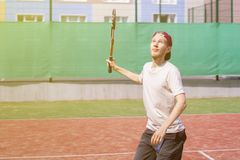Young man playing tennis on the court outdoor making shot stock image