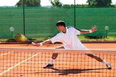 Young man playing tennis Royalty Free Stock Images