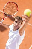 Young man playing tennis Royalty Free Stock Image
