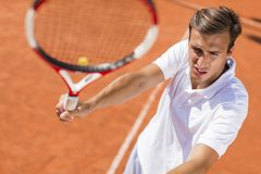 Young man playing tennis. Outdoor Stock Images