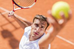 Young man playing tennis Royalty Free Stock Photo