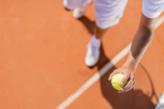 Young man playing tennis Stock Image