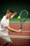 Young man playing tennis Stock Photos
