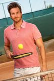 Young man playing tennis smiling royalty free stock photography