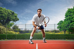 Young man is playing tennis Stock Photography
