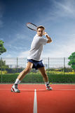 Young man is playing tennis Stock Image