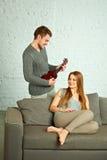 Young man playing ukulele Royalty Free Stock Images