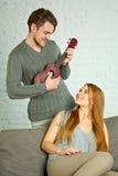 Young man playing ukulele Stock Photography