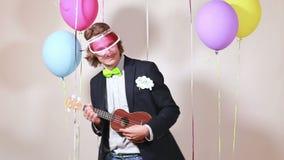 Young man playing ukulele stock video