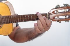 Young man playing ukulele with shirt and black pants royalty free stock photos