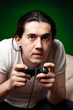 Young man playing video games Royalty Free Stock Photos