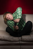 Young man playing video games Royalty Free Stock Images