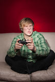 Young man playing video games Royalty Free Stock Photo