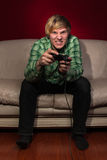 Young man playing video games Royalty Free Stock Photography