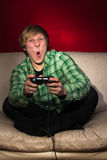 Young man playing video games Stock Photos