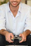 Young man playing video games. Alone Royalty Free Stock Photos