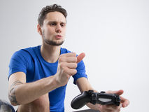 Young man playing video games in black shirt isolated studio Stock Image