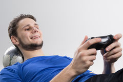 Young man playing video games in black shirt isolated studio Stock Photo