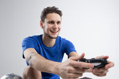 Young man playing video games in black shirt isolated studio Stock Images