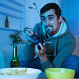 Young Man Playing Video Games Stock Photography