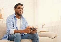 Young man playing video games at home royalty free stock images