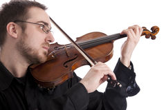 Young man playing the violin Stock Images