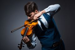 The young man playing violin in dark room Stock Photography