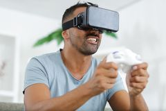 Young man playing with virtual reality glasses royalty free stock image