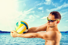 Young man playing volleyball on the beach Royalty Free Stock Image
